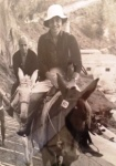 Sue Paul and husband on donkeys in Greece